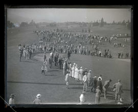 Crowd walking on golf course