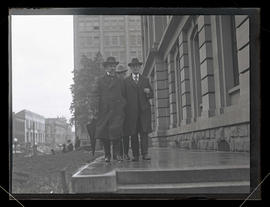 Fred S. Morris, unidentified man, and U. S. Marshal John D. Mann