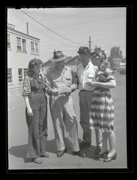 Four unidentified people at Albina Engine & Machine Works, Portland