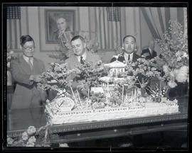 K. Miyako, Portland Mayor Joseph K. Carson, and H. I. Satoh with cake replica of Japanese garden