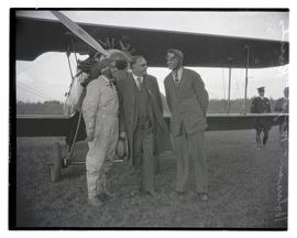 "Air race winners Charles W. ""Speed"" Holman and R. B. Knowles with Mayor George L. Baker"