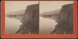 """Rock Bluff from over Tunnel No. 3, Col. River Scenery, Oregon."" (Stereograph E22)"
