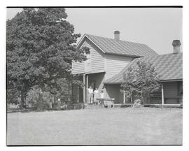 House with family posing on porch