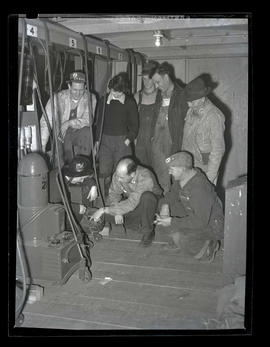 Workers examining equipment at Albina Engine & Machine Works, Portland