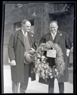 George L. Baker with unidentified man holding floral wreath at Union Station, Portland?