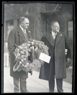 George L. Baker and unidentified man holding floral wreath at Union Station, Portland?