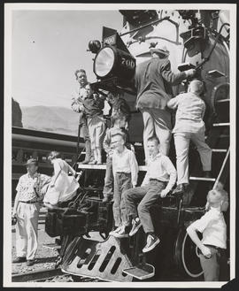 Children and Adults Pose on SP&S Locomotive