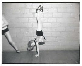 Young dancer doing handstand