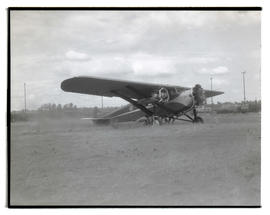 Dick Rankin's airplane in field
