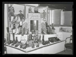 Display of Justin and Bergmann boots and shoes, probably at Pacific International Livestock Expos...