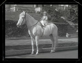 Oswald West's daughter Jean on horseback