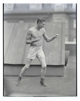 Unidentified boxer facing right