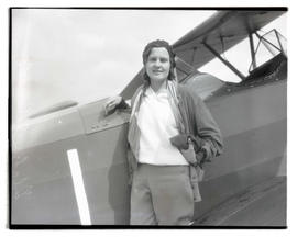 Pilot Gladys O'Donnell with airplane