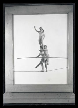 Picture of three women performing high-wire act