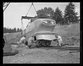 Zoo train locomotive being placed on tracks