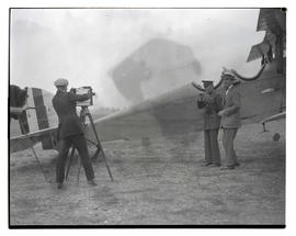 Photographer filming Lieutenant Oakley G. Kelly and Eddie Rickenbacker