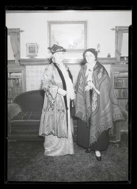 Two costumed people in sitting room