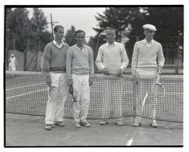Four tennis players on court
