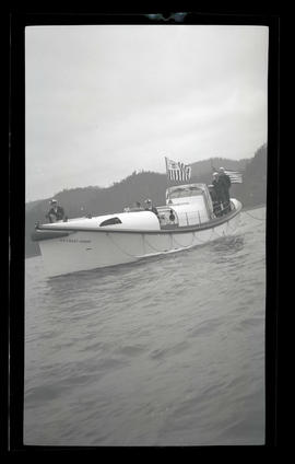 Unidentified people aboard Point Adams Coast Guard station motorboat