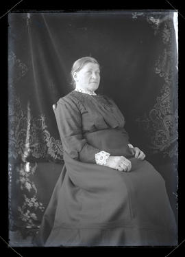 Unidentified woman, seated, three-quarters portrait