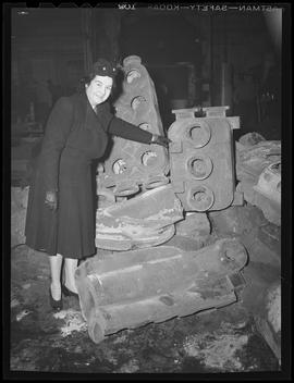 Woman with cast components at Shofner Iron & Steel Works, Portland