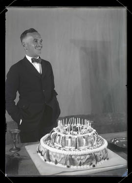 Unidentified man with birthday cake