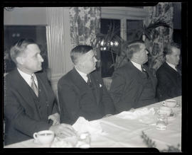 Joseph K. Carson and three unidentified men at dining table