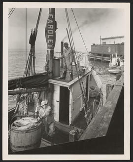 Fishing vessel near refrigerated railcar, Astoria, Oregon