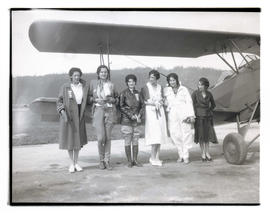 Pilot Gladys O'Donnell and five unidentified women with airplane