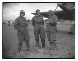 Three men in flight suits, probably at Pearson Field in Vancouver