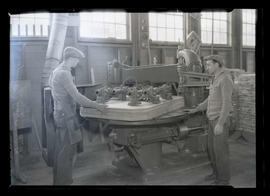 Workers using machinery at B. P. John Furniture Corporation