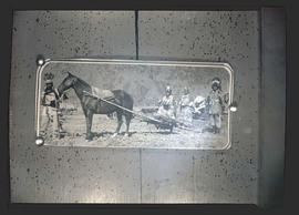 Photograph of Native Americans with horse hitched to drag sled