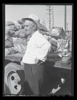 Al Lake standing next to truck loaded with food during market at Albina Engine & Machine Work...