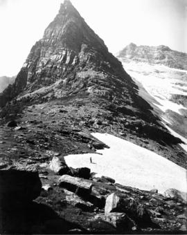 Man on glacier, Gunsight Mountain, Glacier National Park, Montana, 1910