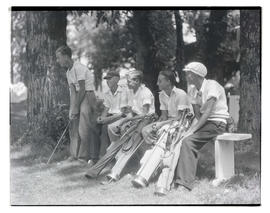 Young golfers on bench