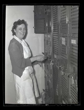 Employee at bank of lockers, Albina Engine & Machine Works Portland
