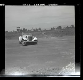 Car skidding sideways during auto race in Tillamook, June 1955