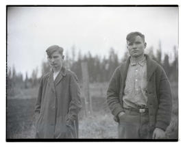 Two unidentified teenage boys outdoors, three-quarters portrait