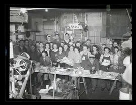 Workers with food and gifts during swing shift, Albina Engine & Machine Works, Portland