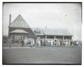 Crowd outside golf clubhouse