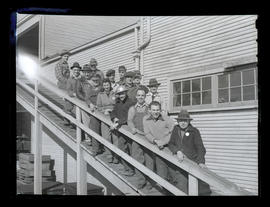 Workers posing on ramp, Albina Engine & Machine Works, Portland