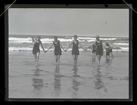 Four women wading in the surf at Seaside, Oregon