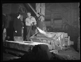 Worker talking to woman at Shofner Iron & Steel Works, Portland