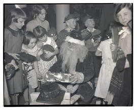 Tommy Luke playing Santa at Christmas party for orphans