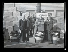 Sid Woodbury IV with group of men at Albina Engine & Machine Works during cigarette drive