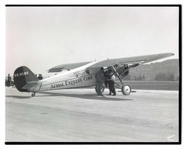 Men with Aerial Express Corp. airplane