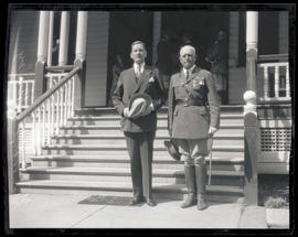 Secretary of War Patrick J. Hurley and Brigadier General Paul A. Wolf, standing outside building