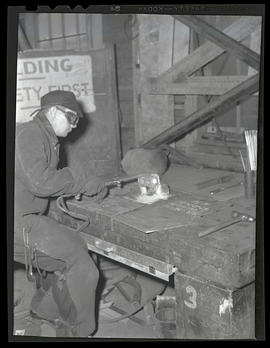 Worker welding at Albina Engine & Machine Works, Portland