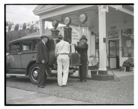 Unidentified men fueling vehicle at General Petroleum station