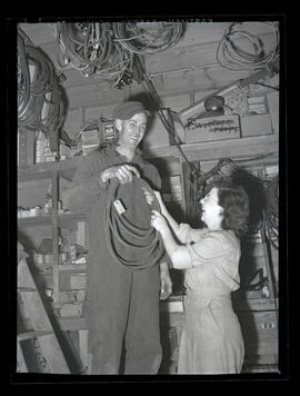 Workers holding cord or cable during graveyard shift at Albina Engine & Machine Works, Portland